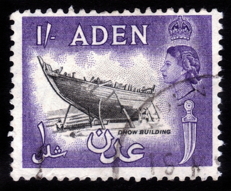 aden: ADEN - CIRCA 1956:  stamp printed in Aden shows dhow - single-masted Arab coasting vessel and image of British Queen Elisabeth. Aden became a crown colony of the UK in 1954. Circa 1956 Editorial