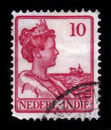 NEDERLAND INDIES - CIRCA 1912: Een stempel gedrukt in Nederland-Indië toont Koningin Wilhelmina van Nederland (1880-1962), circa 1912 Redactioneel