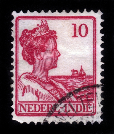 NETHERLANDS INDIES - CIRCA 1912: A stamp printed in the Netherlands Indies shows Queen Wilhelmina of the Netherlands (1880-1962), circa 1912 Editorial
