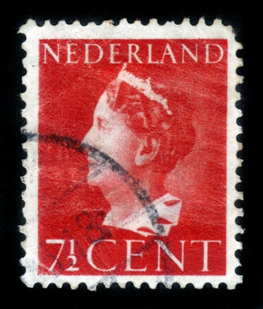 NETHERLANDS - CIRCA 1940: A stamp printed in the Netherlands shows Queen Wilhelmina, circa 1940. Stock Photo - 15485073