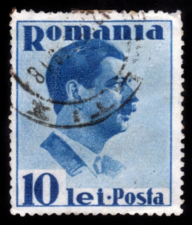 ROMANIA - CIRCA 1935: A stamp printed in the Romania, shows portrait of the King of Romania Carol II on a blue background, circa 1935 Stock Photo - 15485077