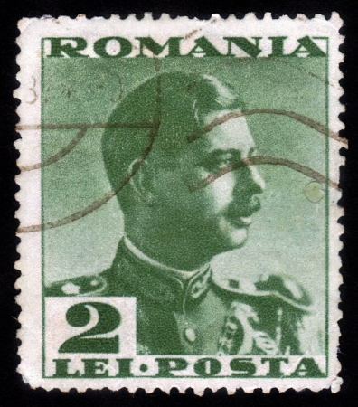 ROMANIA - CIRCA 1935: A stamp printed in the Romania, shows portrait of the King of Romania Carol II on a green background, circa 1935
