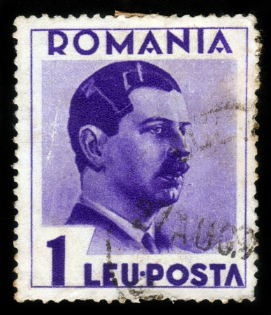 ROMANIA - CIRCA 1935: A stamp printed in the Romania, shows portrait of the King of Romania Carol II on a violet background, circa 1935 Stock Photo - 15485076