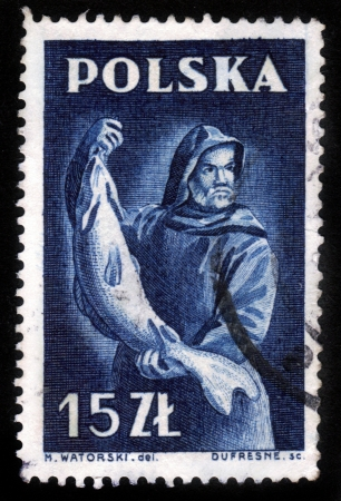POLAND - CIRCA 1950s: A stamp printed in Poland shows a fisherman holding a large fish, circa 1950s.