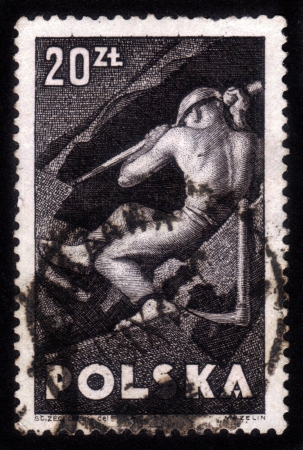 POLAND - CIRCA 1947: A stamp printed in Poland shows worker in coal mine, circa 1947 Stock Photo - 15485082