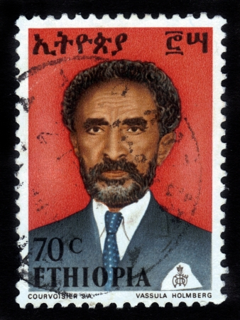 haile: ETHIOPIA - CIRCA 1958 : A stamp printed in Ethiopia shows image of  emperor Haile Selassie on a red background , with the inscription in Amharic , series, circa 1958 Stock Photo