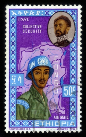 ETHIOPIA - CIRCA 1962: A stamp printed in the Ethiopia, shows image of emperor Haile Selassie and UN soldiers on a map of the Congo, circa 1962 Stock Photo
