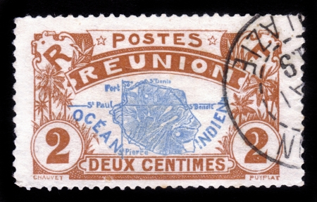 REUNION - CIRCA 1907: A stamp printed in Reunion shows Map of Reunion island , island in the Indian Ocean, east of Madagascar, overseas region of France , circa 1907 photo