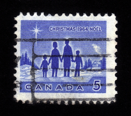 CANADA - CIRCA 1964: stamp printed by Canada, shows Christmas scene with happy family and Star of Bethlehem, circa 1964 Stock Photo - 15724329