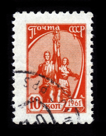 USSR- CIRCA 1961: a stamp printed by USSR, shows Worker and Farmer by V.I. Muhin - Symbols USSR, Moscow, circa 1961 Stock Photo - 15724327