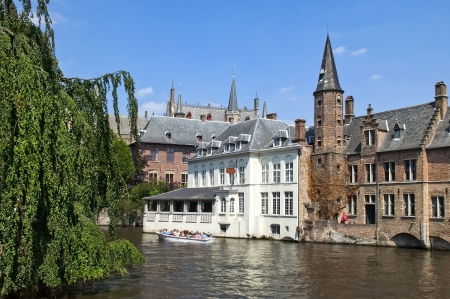 Walk through the picturesque canals of Ghent Belgium, typical architecture of the city photo