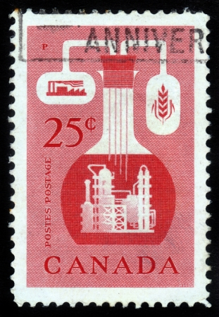 CANADA - CIRCA 1956: A stamp printed in Canada shows  the chemical industry of Canada, circa 1956. Stock Photo - 15819668