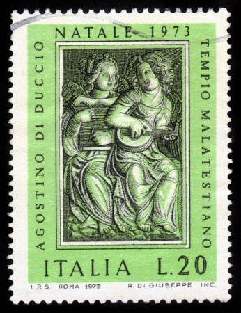 ITALY - CIRCA 1973: stamp printed by Italy, shows Angels by Agostino di Duccio,  Christmas, circa 1973 Stock Photo - 15819677