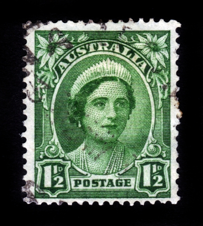 AUSTRALIA - CIRCA 1942: A stamp printed in Australia shows image of Elizabeth Bowes-Lyon was the Queen consort of King George VI, circa 1942. photo