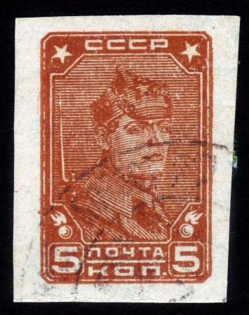 USSR - CIRCA 1931: A Stamp printed in USSR shows portrait of an officer of the Red Army during the civil war in the Soviet Union, circa 1931 Stock Photo - 15819641