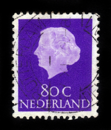 wilhelmina: NETHERLANDS - CIRCA 1953: A stamp printed in Netherlands shows portrait of Queen regnant of Netherlands Juliana Louise Emma Marie Wilhelmina on a blue background ,circa 1953 Editorial