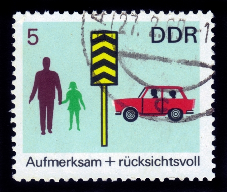 GERMANY - CIRCA 1969: stamp printed by Germany, shows car, pedestrians and pedestrian crossing sign, series Road safety , circa 1969 Stock Photo - 16007414