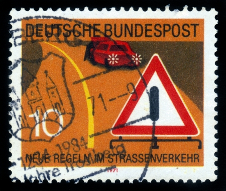 GDR (EAST GERMANY) - CIRCA 1971: a stamp printed in GDR (East Germany) shows new road traffic regulations and car , devoted to the explaining rules of the road,  series Road safety, circa 1971 Stock Photo - 16007421