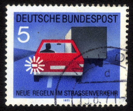 GDR (EAST GERMANY) - CIRCA 1971: a stamp printed in GDR (East Germany) shows car, truck and light signal, devoted to the explaining rules of the road,  series Road safety, circa 1971 Stock Photo - 16007418