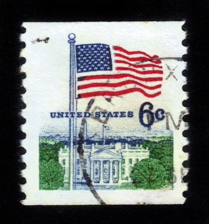 UNITED STATES - CIRCA 1967: stamp printed in United states (USA), shows image of White House and American Flag, from series Flag Issue, circa 1967