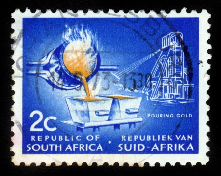 SOUTH AFRICA - CIRCA 1960: A stamp printed in South Africa, shows process of smelting gold, circa 1960 Stock Photo - 15987062