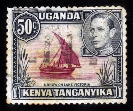 protectorate: UGANDA, KENYA AND TANGANYIKA - CIRCA 1938: A stamp printed in Uganda Protectorate shows sailing ship on a Lake Victoria, circa 1938