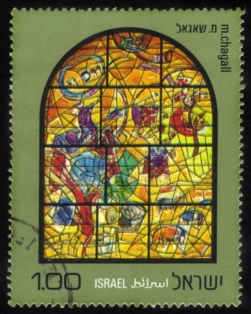 ISRAEL - CIRCA 1973  a stamp printed by Israel shows  the Chagall Windows in the synagogue, Hadassah Hospital , Jerusalem in honor of 12 Tribes of Israel    Joseph, series, circa 1973 Stock Photo - 15987061