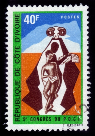 cote d'ivoire: COTE D IVOIRE - CIRCA 1970  A stamp printed in Republic Cote d Ivoire shows two indigenous inhabitants and head of spiral-horned sheep , devoted 5 Congress of Democratic Party , circa 1970