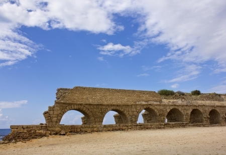 Ancient Roman aqueduct at Ceasarea along the coast of the Mediterranean Sea, Israel. photo