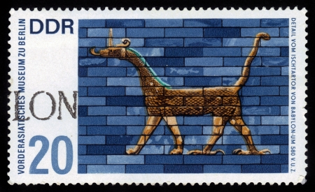 ishtar gate of babylon: GERMANY - CIRCA 1972  a stamp printed in Germany  East Germany  shows Museum of the Ancient Near East in Berlin, detail from the Ishtar Gate of Babylon , circa 1972