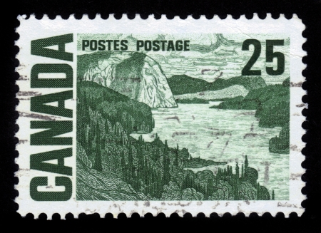 CANADA - CIRCA 1967  A stamp printed by Canada, shows painting   The Solemn Land   by J  E  H  Macdonald, circa 1967 Stock Photo - 16127278