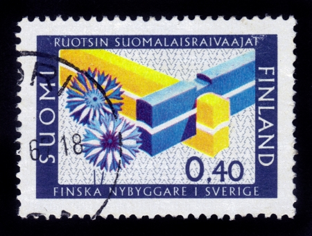 FINLAND - CIRCA 1967  a stamp printed in the Finland shows Double Mortise Corner, Finnish Settlers in Sweden, Symbolize unity of the two countries , circa 1967 Stock Photo - 16126275