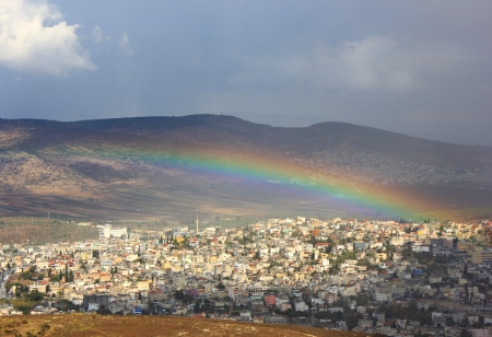 first miracle: rainbow over the arab village Cana of Galilee in Israel , place where Christ showed first miracle Stock Photo