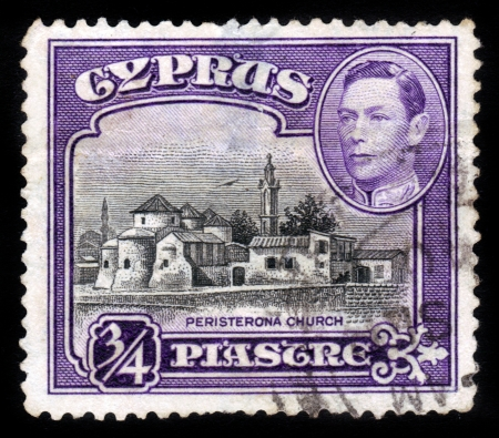 st hilarion: CYPRUS - 1938  A stamp printed in Cyprus shows Church of St  Barnabas and St  Hilarion, Peristerona, 1938 Editorial