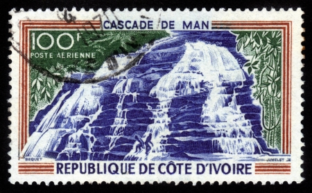 COTE D IVOIRE - CIRCA 1970  A stamp printed in Republic Cote d Ivoire shows Man Waterfalls in Cote Ivoire , circa 1970