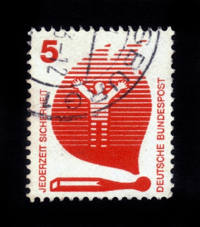 GERMANY - CIRCA 1971: A stamp printed in Germany shows person in the flames of a burning match, Accident Prevention series, circa 1971 Stock Photo - 16127288