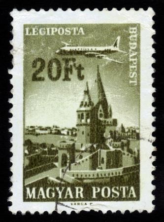 HUNGARY - CIRCA 1966  stamp printed by Hungary, shows Plane over Budapest, Fisherman s Bastion ,circa 1966 Stock Photo - 16233020