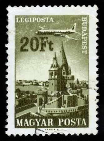 HUNGARY - CIRCA 1966  stamp printed by Hungary, shows Plane over Budapest, Fisherman s Bastion ,circa 1966 Stock Photo - 16233020