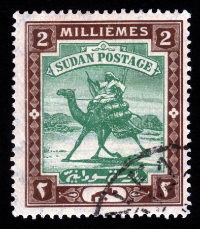 postman of the desert: SUDAN - CIRCA 1898  A stamp printed in Sudan shows Arab postman, 2 millieme ,seria The Camel Post , circa 1898