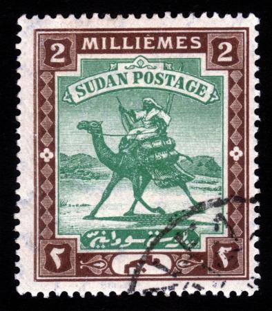 camel post: SUDAN - CIRCA 1898  A stamp printed in Sudan shows Arab postman, 2 millieme ,seria The Camel Post , circa 1898