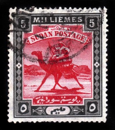 camel post: SUDAN - CIRCA 1898  A stamp printed in Sudan shows Arab postman, 5 millieme ,seria The Camel Post , circa 1898 Editorial