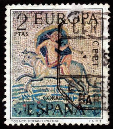 SPAIN - CIRCA 1973: a stamp printed in the Spain shows Abduction of Europa, Roman Mosaic, circa 1973 Stock Photo - 16233027