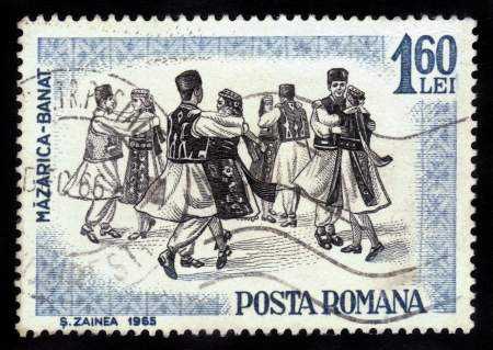 ROMANIA - CIRCA 1965: A stamp printed by Romania, shows folk dancers of Romania,  Banat region is the Southwestern region of Romania , circa 1965
