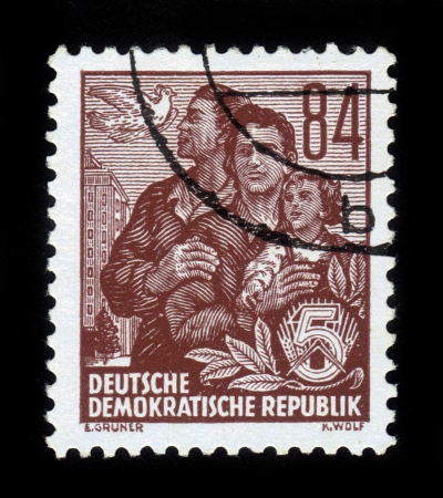 weber: GDR - CIRCA 1953: A stamp printed in GDR (German Democratic Republic - East Germany) shows family and pigeon , High-rise on Wiese Weber, Berlin , series Workers For The Five-year Plan, circa 1953