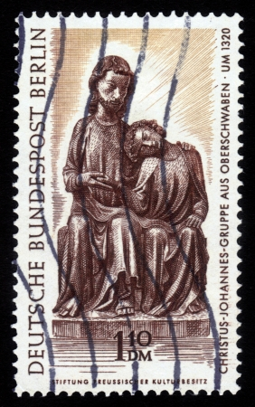 FEDERAL REPUBLIC OF GERMANY - CIRCA 1967  A stamp printed in Germany shows Christ-John Group, Holsstatue an unknown sculptor in 1320, circa 1967 Stock Photo - 16233037