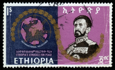ETHIOPIA - CIRCA 1960 : A stamp printed in Ethiopia shows image of  emperor Haile Selassie on against the background of the world map, is dedicated to international relation of Ethiopia , with the inscription international relation , series, circa 1960 Stock Photo - 16348372