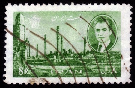 IRAN - CIRCA 1966: A stamp printed in Iran shows Shah Mohammad Reza Pahlavi, on background of ruins of Persepolis, capital of ancient Persia, destroyed armies of Alexander of Macedon, 1966 Stock Photo - 16348367