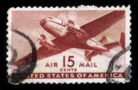 postage stamp: UNITED STATES OF AMERICA - CIRCA 1950s: A stamp printed in the USA shows two engine transport plane, circa 1950s
