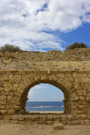 view of the Mediterranean Sea through a stone arch of the ancient Roman aqueduct , Caesarea, Israel Stock Photo