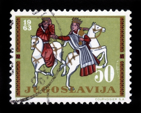 YUGOSLAVIA - CIRCA 1963  a stamp printed by Yugoslavia shows King and Queen on horseback, circa 1963 Stock Photo - 16348396